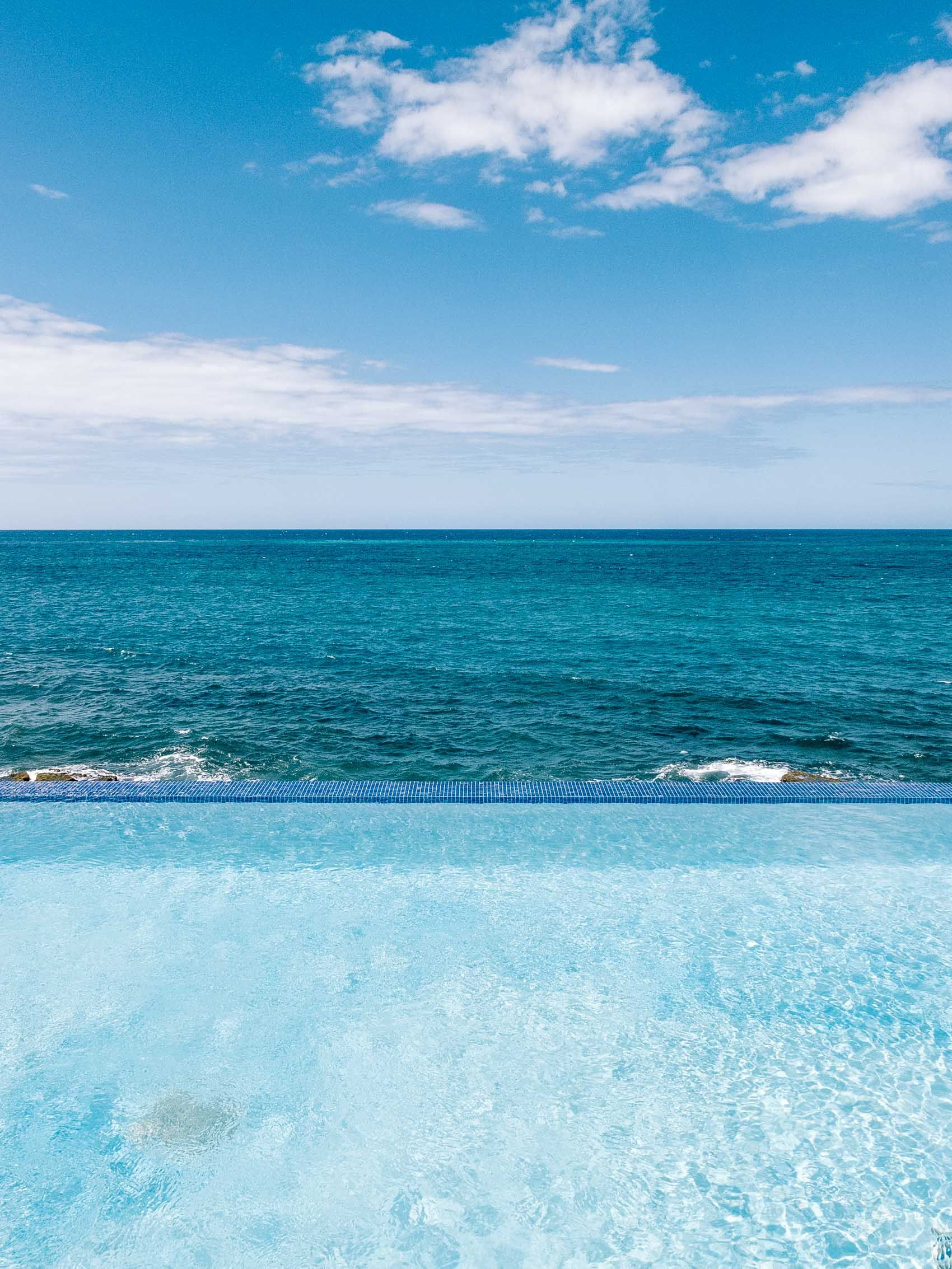 infinity pool overlooking the caribbean ocean at the condado