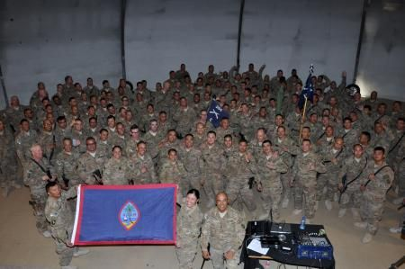 Soldiers from 1st Battalion, 294th Infantry Regiment, Guam Army National Guard gather in Kabul, Afghanistan, after their Dec. 26 Casing Ceremony to sing Fanohge Chamorro -- Guam's national anthem -- in representation of their island pride and dedication to two fallen heroes who won't return to their Pacific Island home. The Soldiers pictured represent the last group of Task Force Guam's nearly 600-member battalion that today ended nine months of Operation Enduring Freedom.