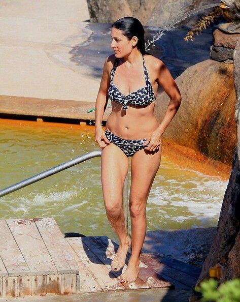 With her slim body and Dark brown hairtype without bra (cup size 34B) on the beach in bikini