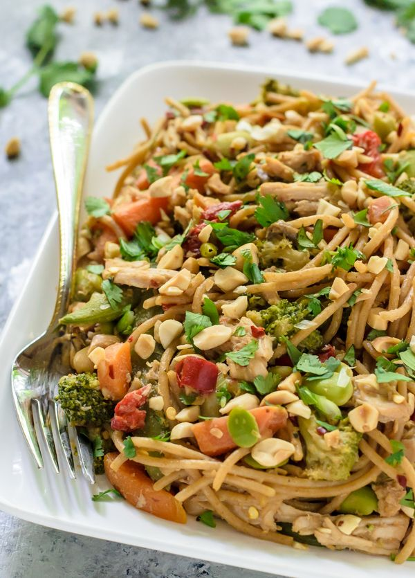 An easy slow cooker pork stir fry in a sweet and tangy peanut sauce, served over peanut noodles. Great for weeknights, entertaining, and leftovers too!