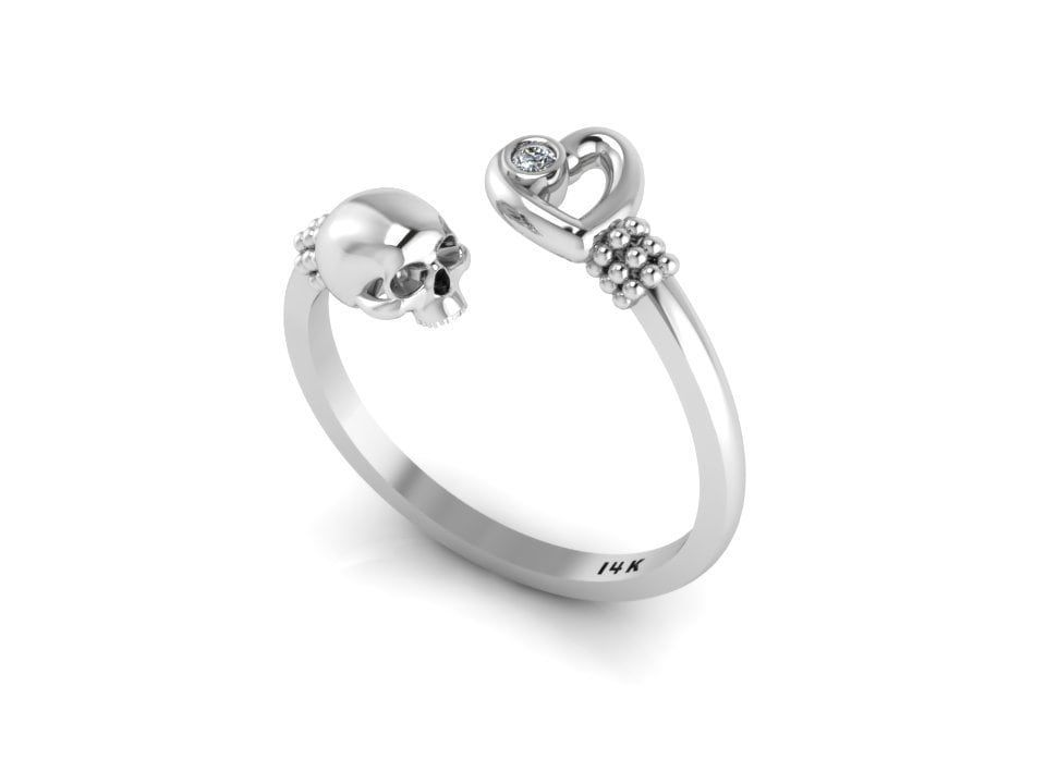 """""""White Gold Skull Heart Diamond Ring Eternal Love Gothic Mini Skull Ring Stacking Band Goth Jewelry Our new stacking ring. \""""Eternal Love\"""" is made in solid 14k White Gold featuring a delicate skull facing a beautiful heart. The heart has a genuine White (or Black) Diamond G-H, SI-1, 0.015ct (1.6mm) bezel set bringing life to this delicate ring. Elegant ring making a bold statement. Please, select your finger size at check out. If you dont see your size send us a message for a price quote. This"""