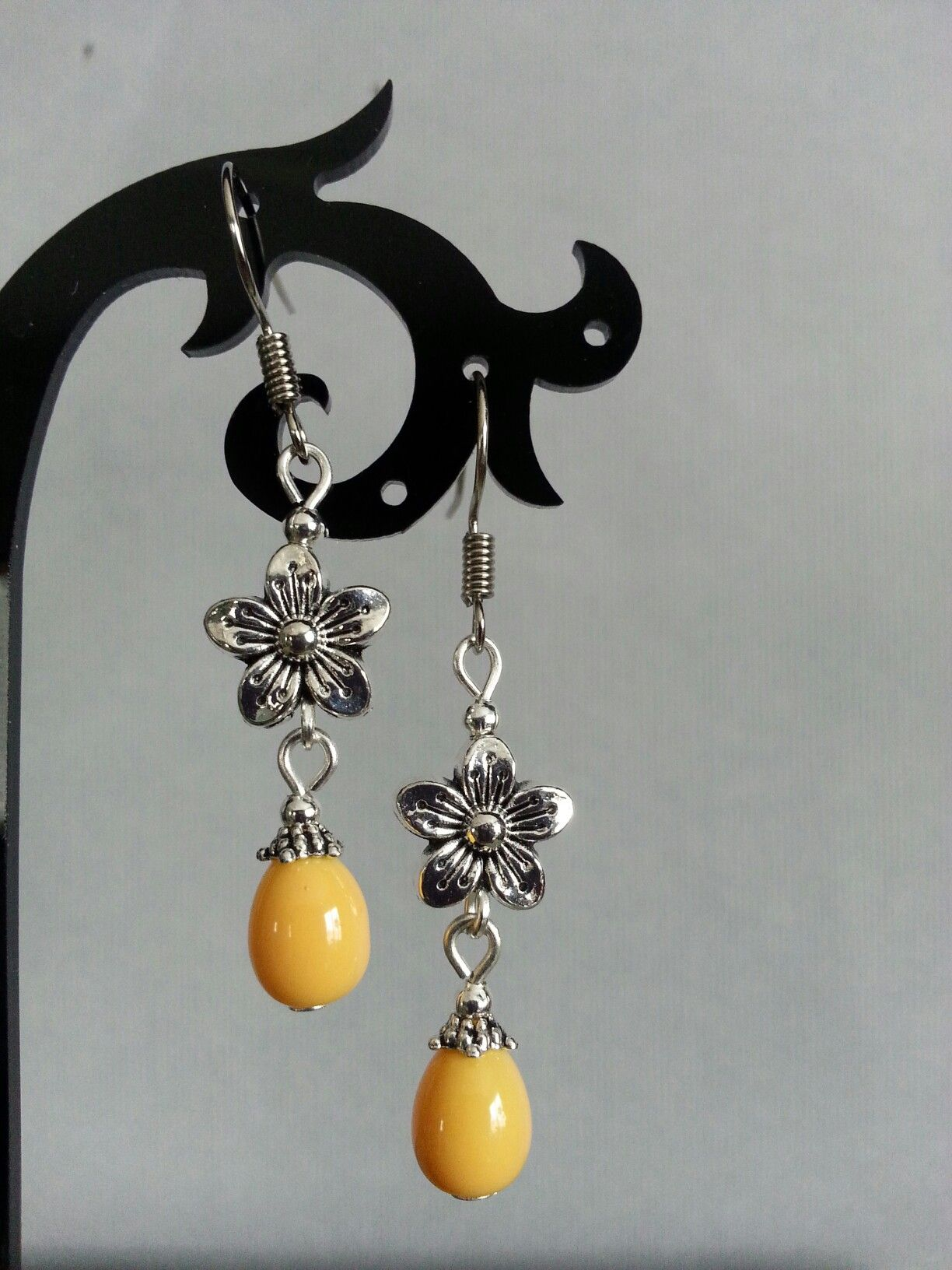 Tibetan silver flower and yellow glass beads. Designs By Hania.