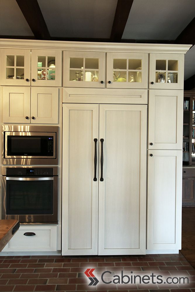 These shaker style antique white cabinets with a brushed