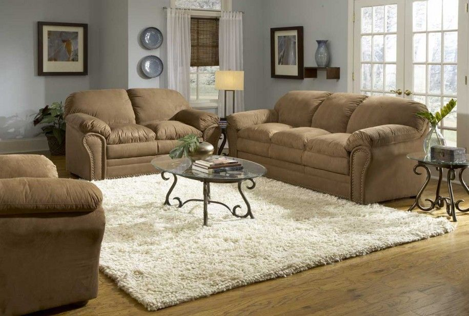 light gray walls with brown leather couch brown