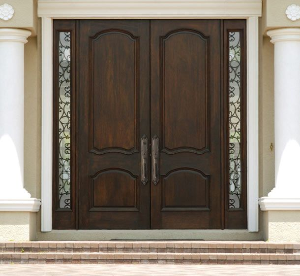 Double Entrance Doors   Double wood door with wrought iron ...