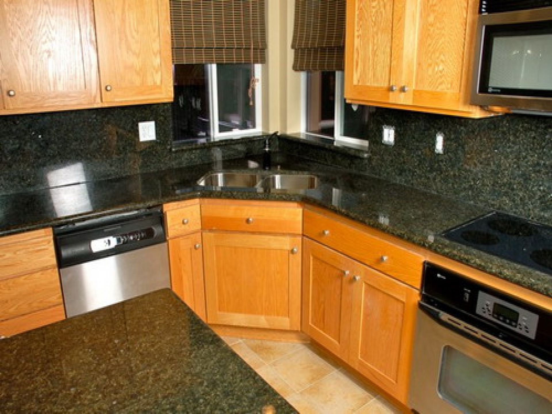 Fashionable Corner Kitchen Sink With Unstained Oak Kitchen Cabinet With Dark Granite Countertop As Well As Grey Wa