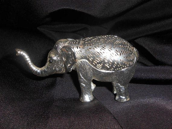 Christofle Lumiere D'Argent Collection Silverplate Baby Elephant Figurine Figure Decor Gifts France 1970s. Measuring 1 1/2 tall and approx 3 long.