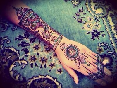 Girl with a Henna design on her hand & arm