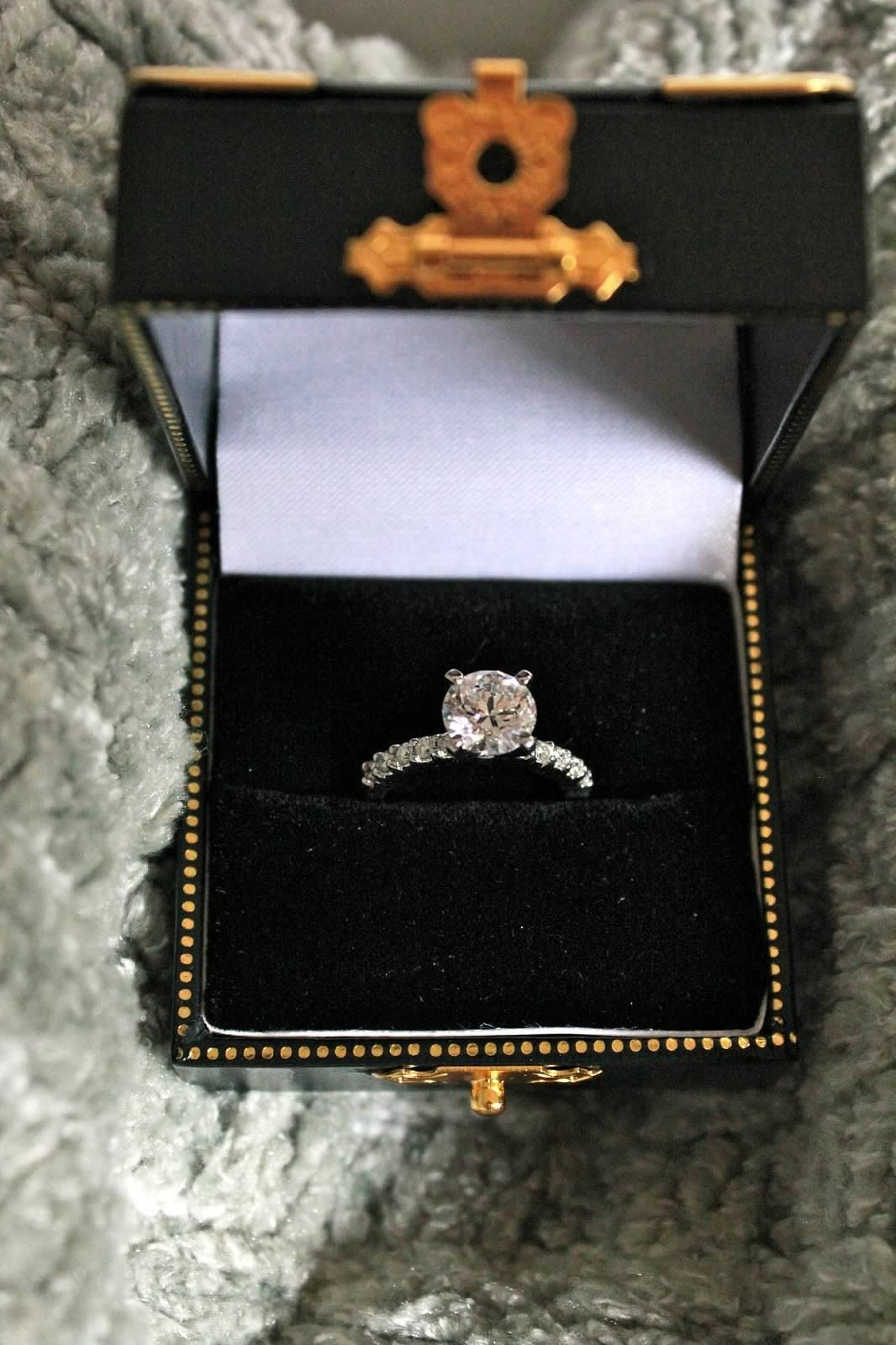 Round solitaire platinum engagement ring diamond band