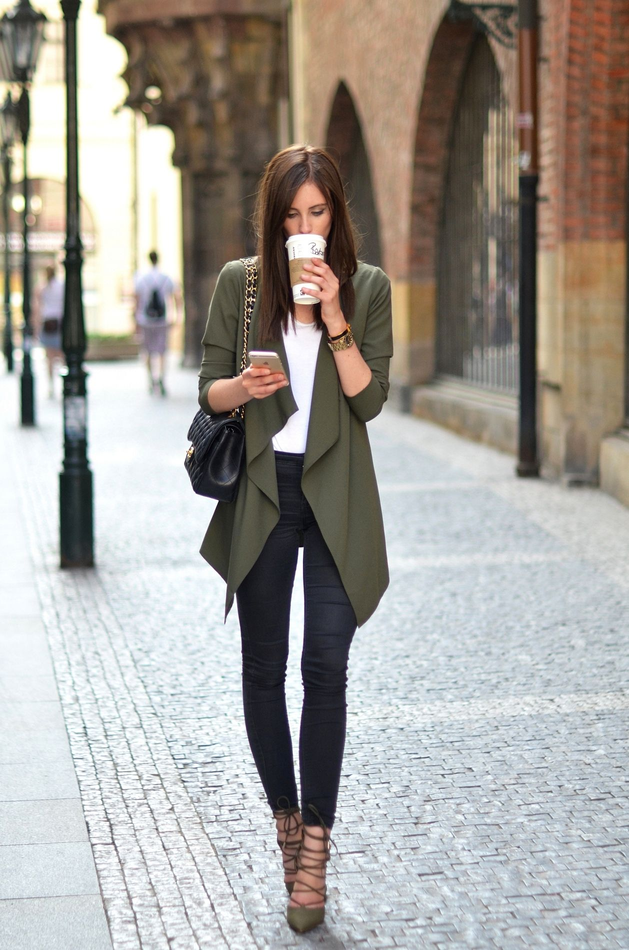I like this type of look for the weekend -- an oversized, green jacket and skinny jeans (especially with boots!)