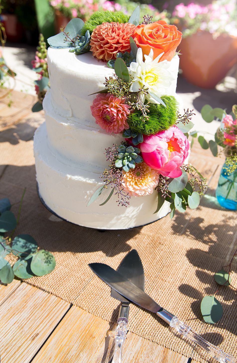 Rustic white wedding cake with bright florals