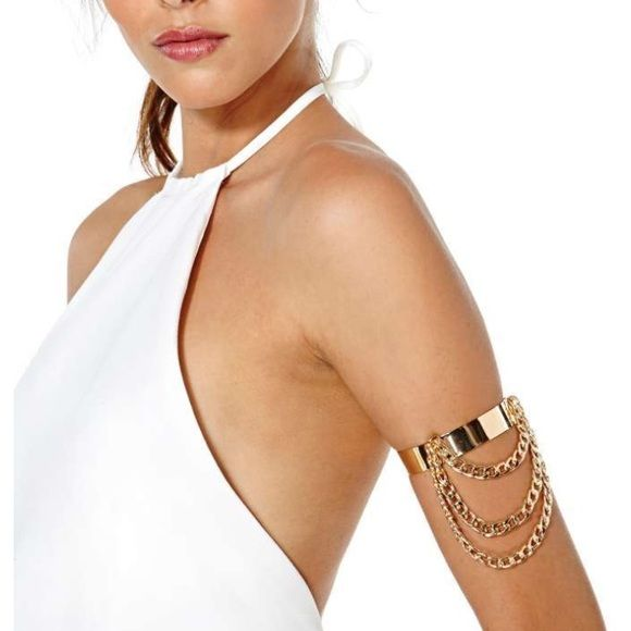 """#74 It's sleeveless season, so why not decorate those arms with this awesome gold arm band? It features hanging gold chains and an adjustable closure. Looks perfect with a minimal, neutral dress and strappy heels!  *Length: 4.5""""/11.5cm  *Width: 3""""/7.5cm  *Imported Nasty Gal Jewelry Bracelets"""