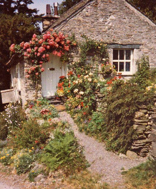 Stone House & Flowers Over Door