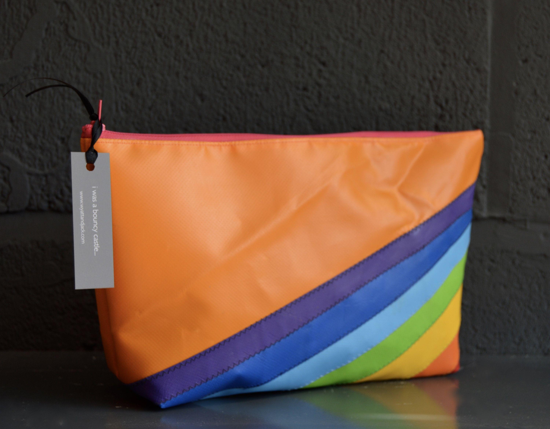407f81550a50 Recycled PVC Orange Rainbow Waterproof Vegan Weekend Wash Bag | Kit ...