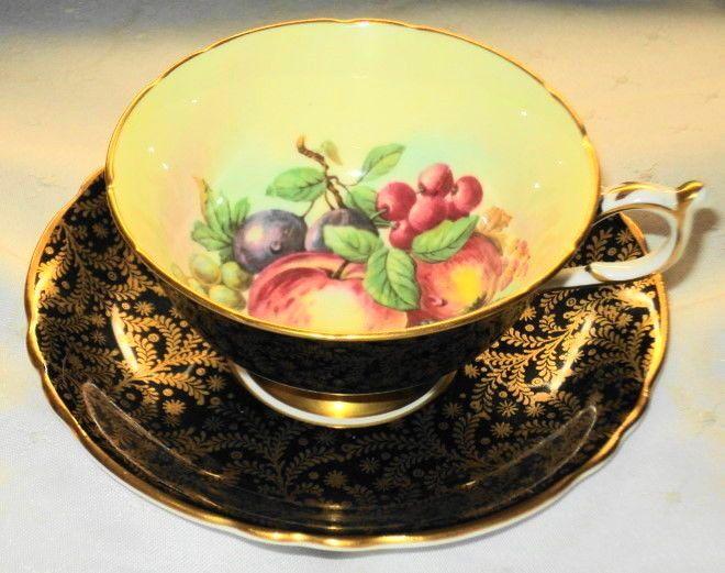 PARAGON ENGLAND APPLE FRUIT BERRYBLACK GOLD CHINTZ TEA CUP AND SAUCER