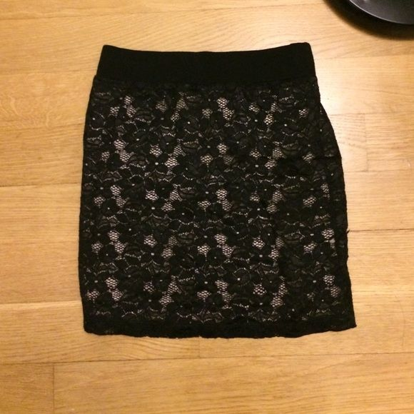 Black skirt Black lace-like skirt. Soft with elastic band on top that adds for comfort Forever 21 Skirts Mini