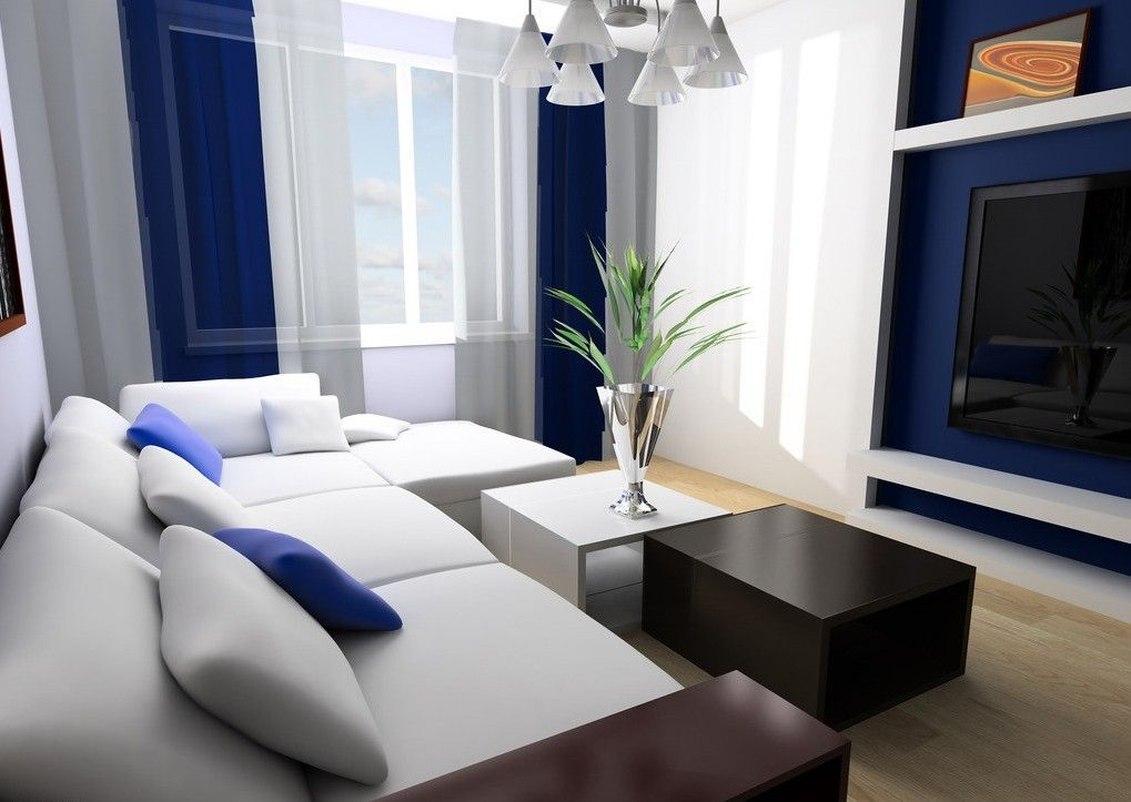 Beautiful Blue Themed Living Room Decorated With L Shaped White Fabric Sectional Sofa Design And