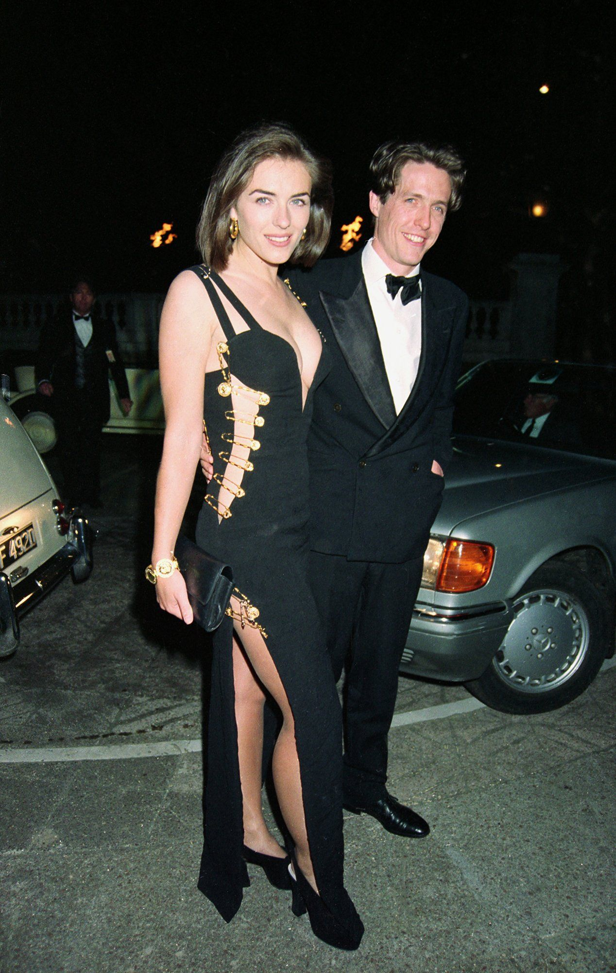 The Best Red Carpet Moments Of The 90s Elizabeth Hurley Gwyneth Paltrow And Madonna Iconic Dresses Celebrity Dresses Elizabeth Hurley