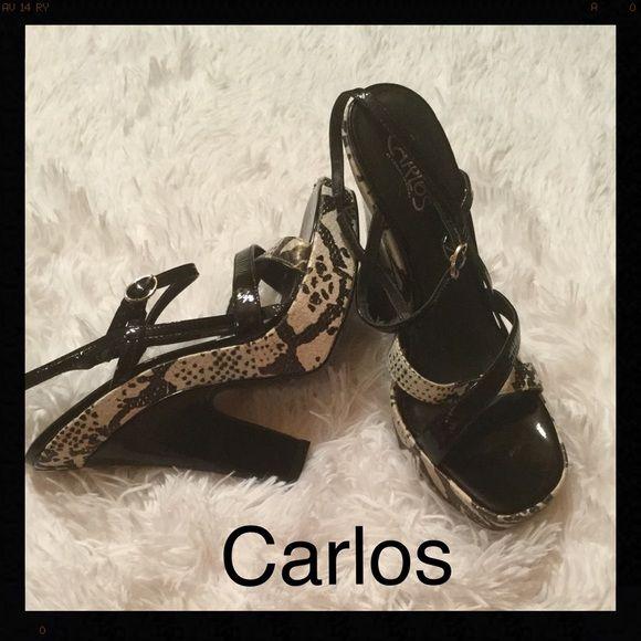 Carlos by Carlos Santana platform heel. Cute 4 inch platform heel, has black and white pattern with straps.  Very nice and gently used. Carlos Santana Shoes Heels