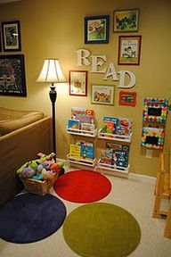 Reading corner - I love the wooden letters (from JoAnn's & painted white) & the framed book covers. IKEA spice racks painted white for the bookshelves and dot rugs from IKEA. I would love to do this in a corner of our family room!