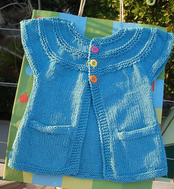 No pattern - just idea. - See: Ravelry: in threes: a baby cardigan pattern by Kelly Herdrich - $6