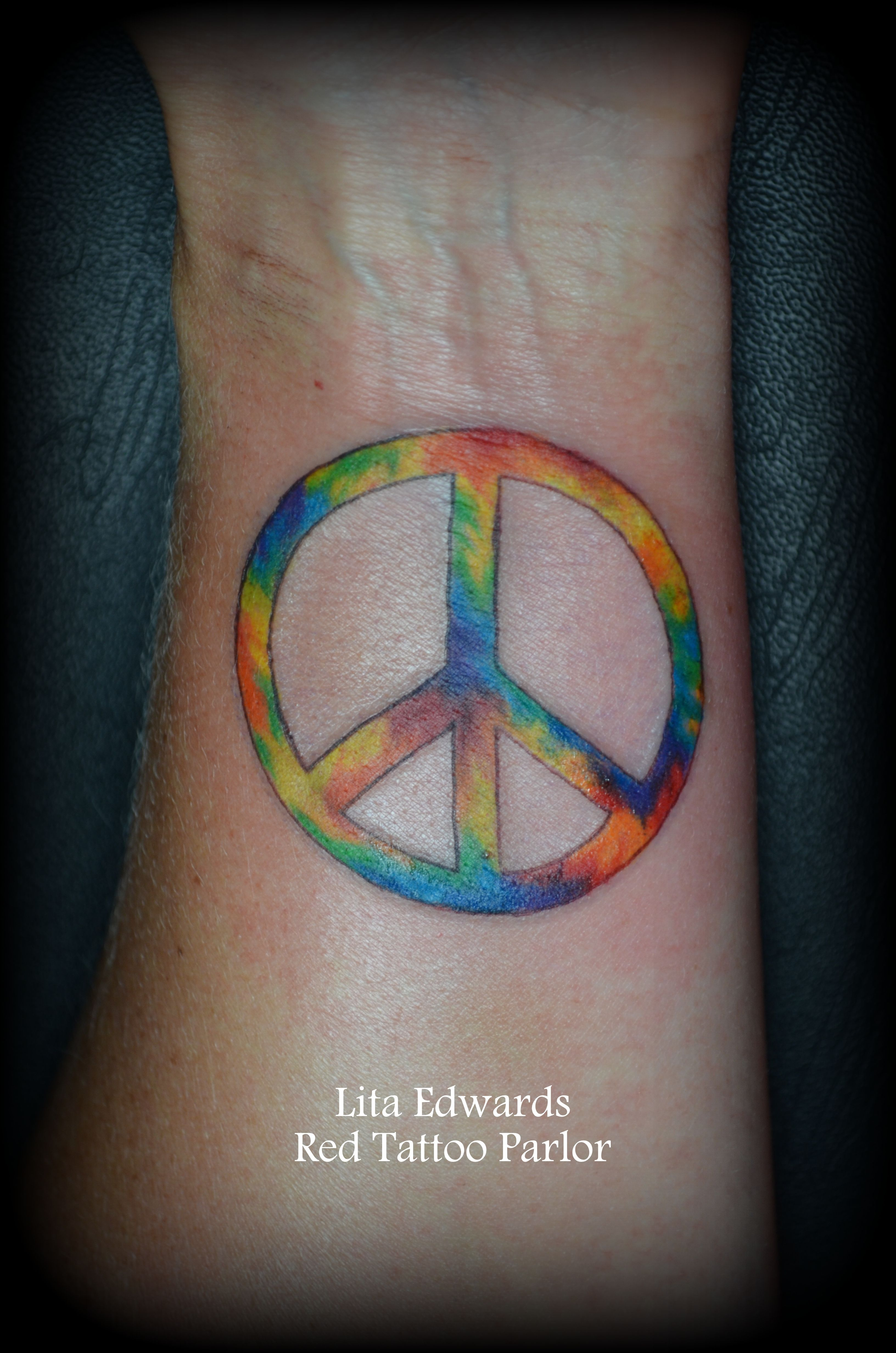 Tie Dye Peace Sign Wrist Tattoo Lita Edwards Redtattooparlor Nashville Peace Sign Tattoos Hippie Tattoo Peace Tattoos