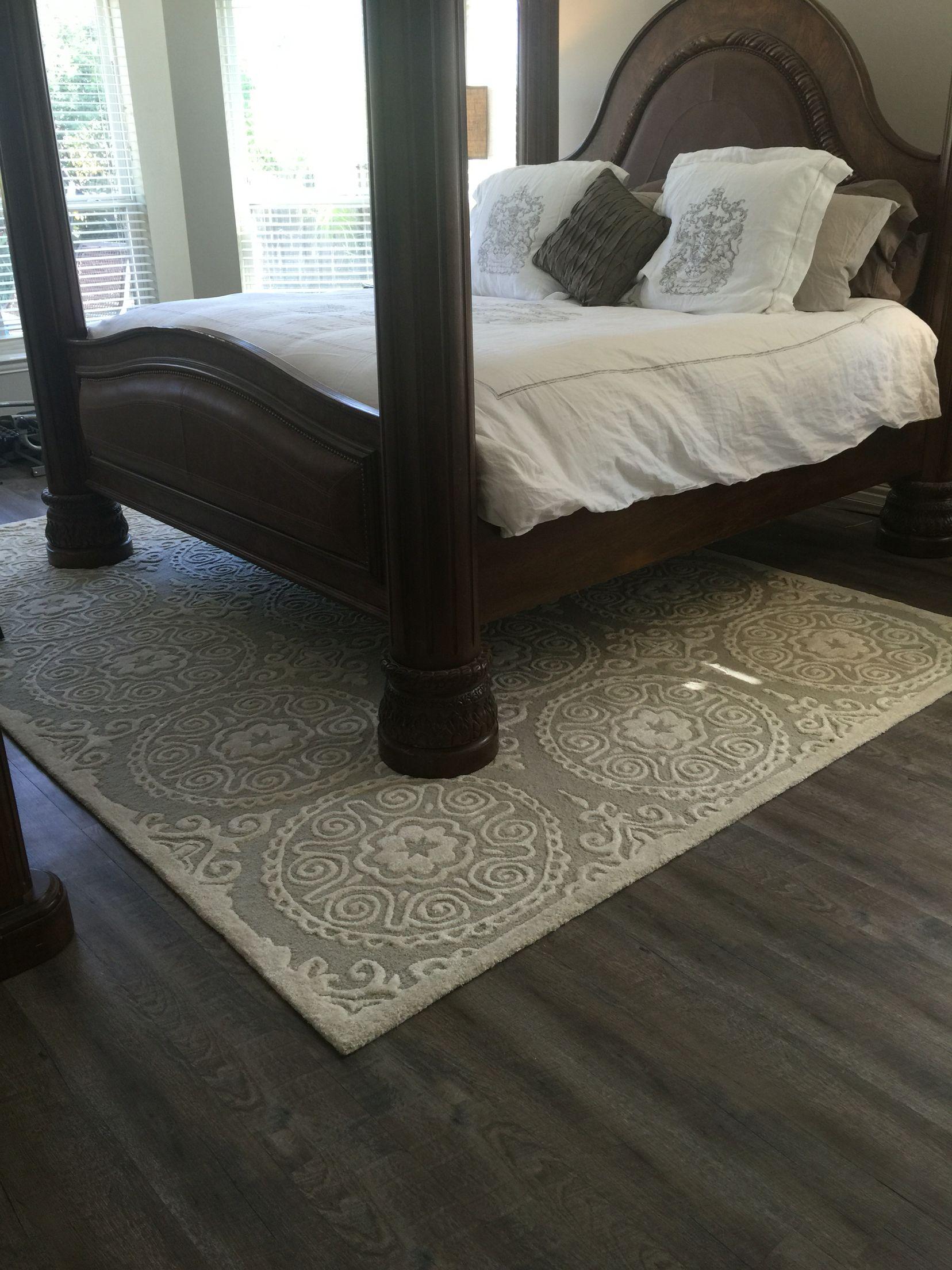 Peel and stick vinyl Driftwood flooring in master bedroom