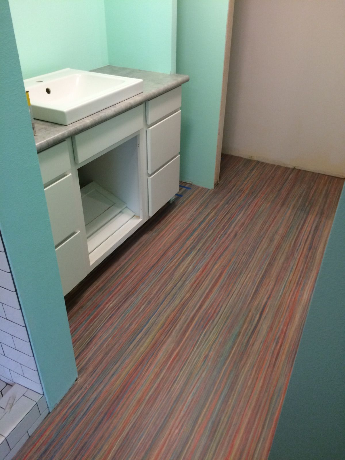 Bathroom remodel forbo marmoleum striato style before for Lino flooring for bathrooms