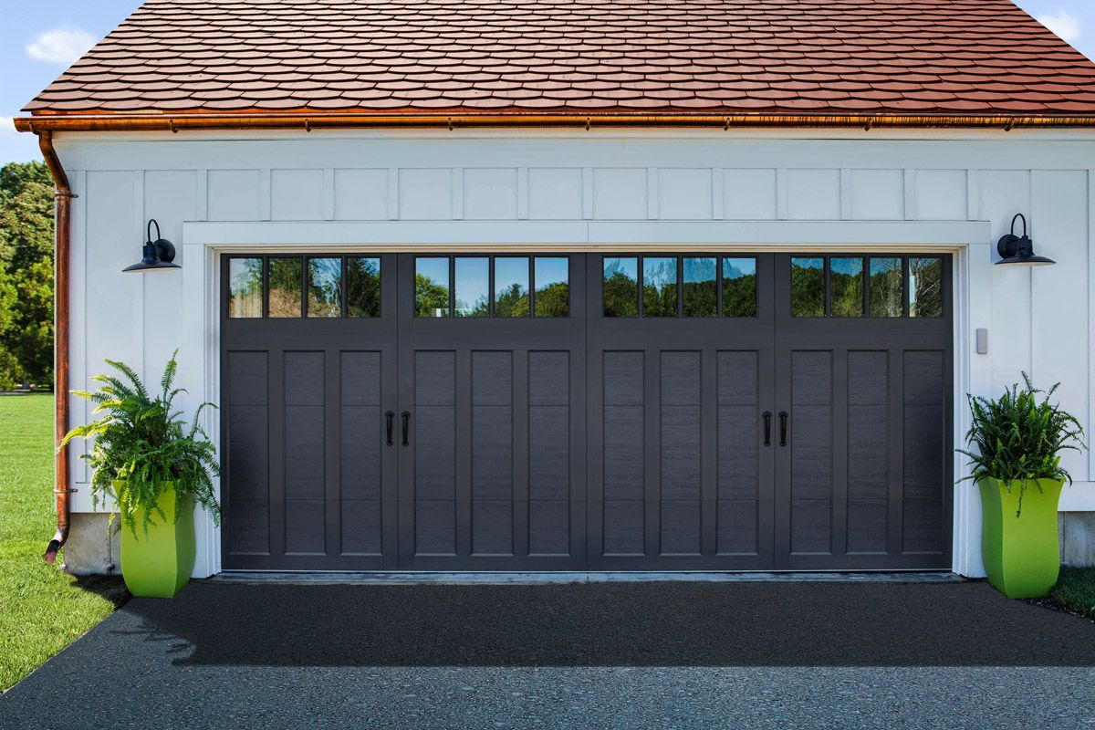 Clopay coachman collection carriage house garage door on a white clopay coachman collection carriage house garage door on a white farmhouse garage with gooseneck lights rubansaba