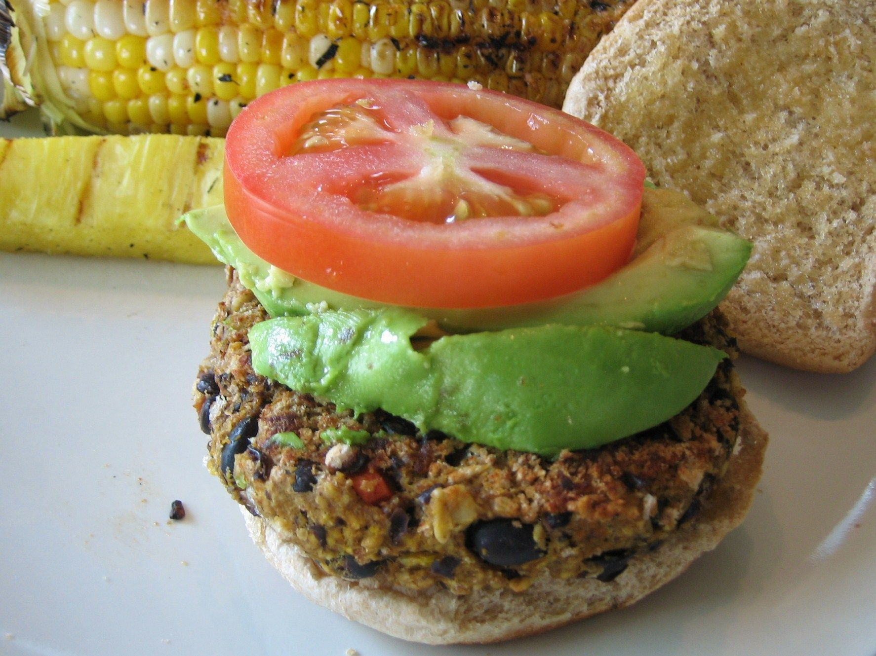 Sweet Potato Black Bean Burgers - finally a perfectly cooked thick veggie burger that really satisfies. The secret--coating in panko bread crumbs, pan frying, then baking.