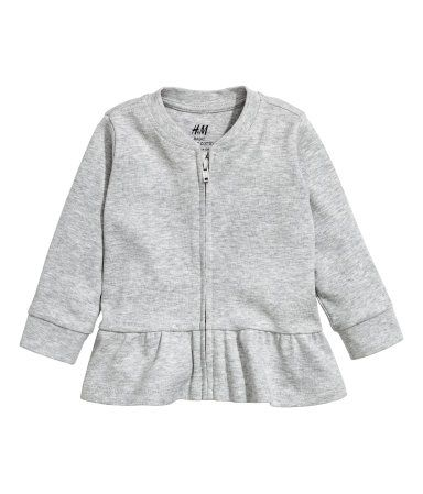 3852906265253e Cardigan in soft, organic cotton jersey. Zip at front and ruffle at hem.  Ribbed cuffs.