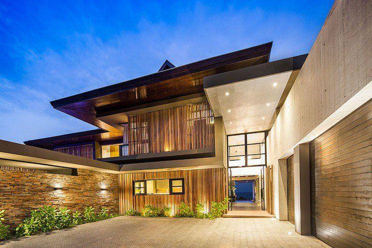 Bardage bois vertical et parement en béton du0027une maison du0027architecte