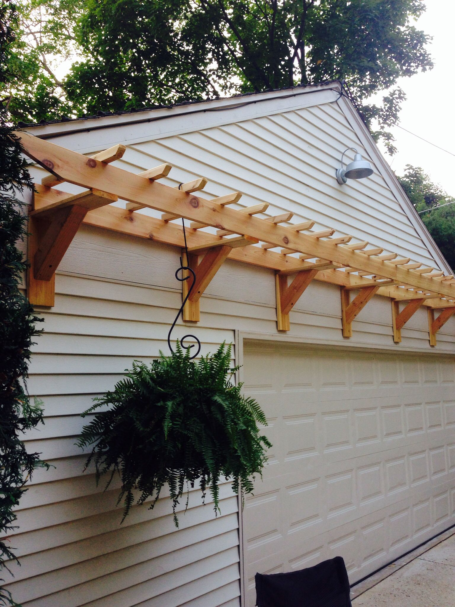 Garage door trellis or arbor project Made with cedar decking and