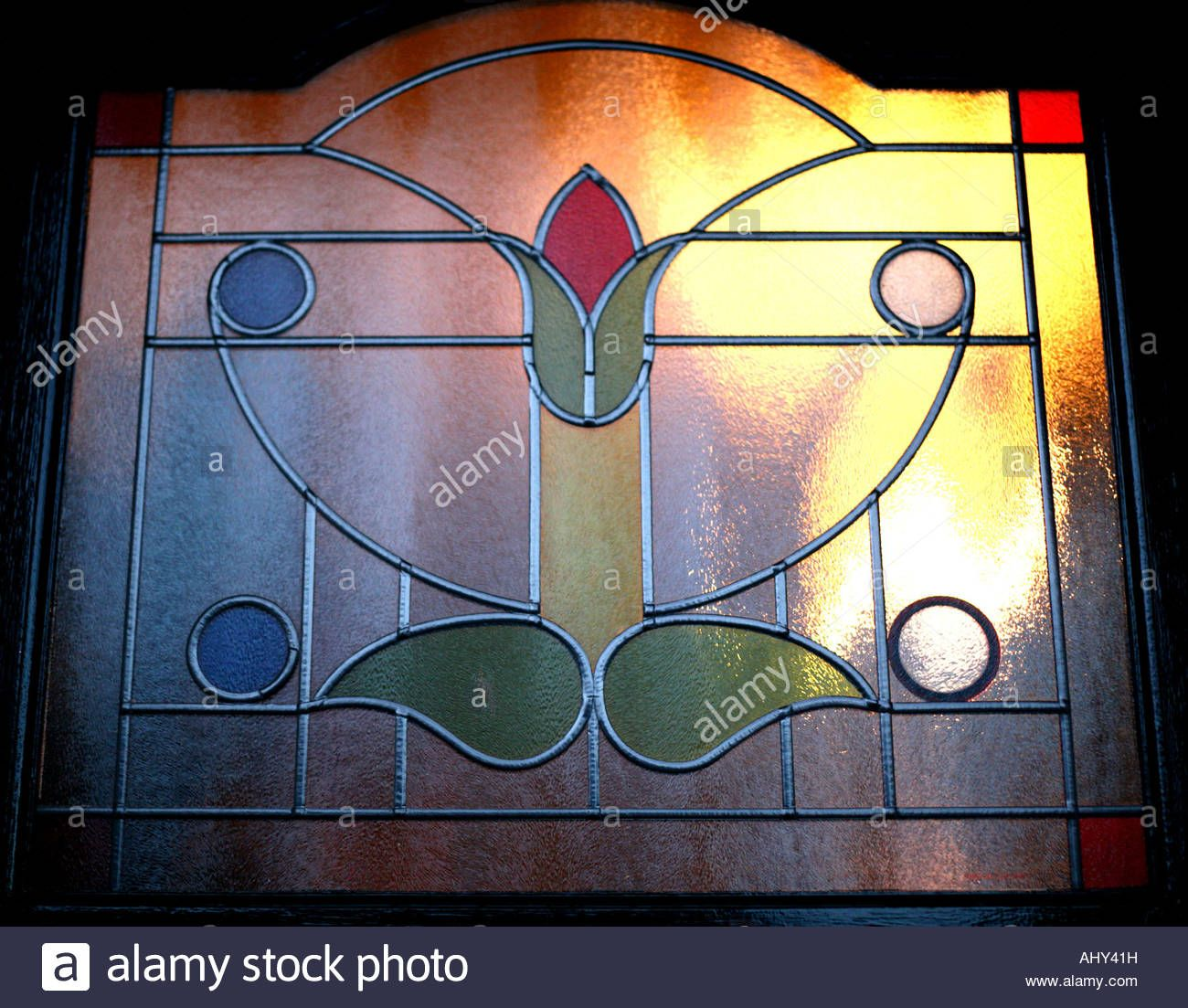 Download this stock image night view of a stained glass front door