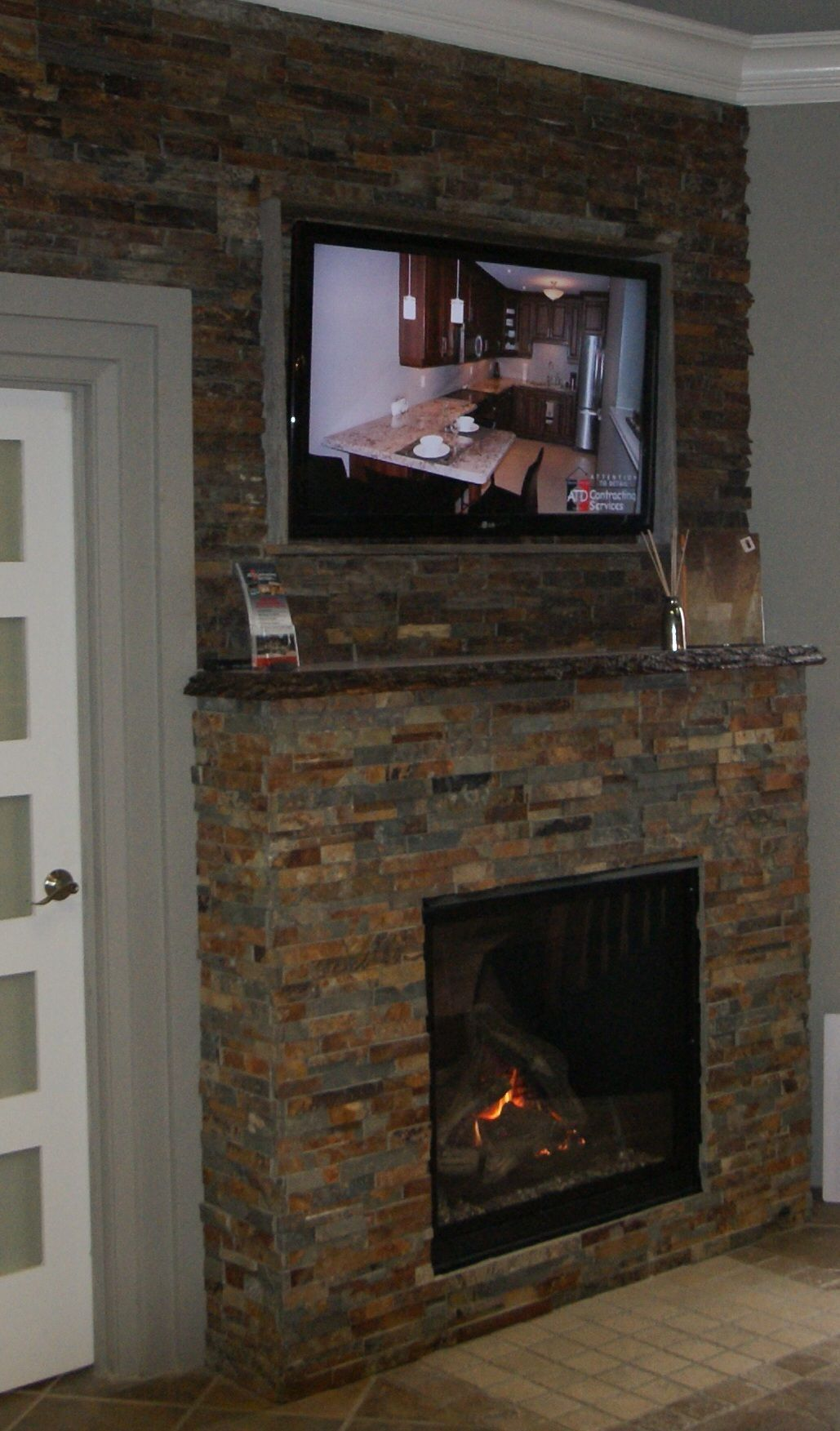 custom fireplace, natural stone fireplace, tv mounted over