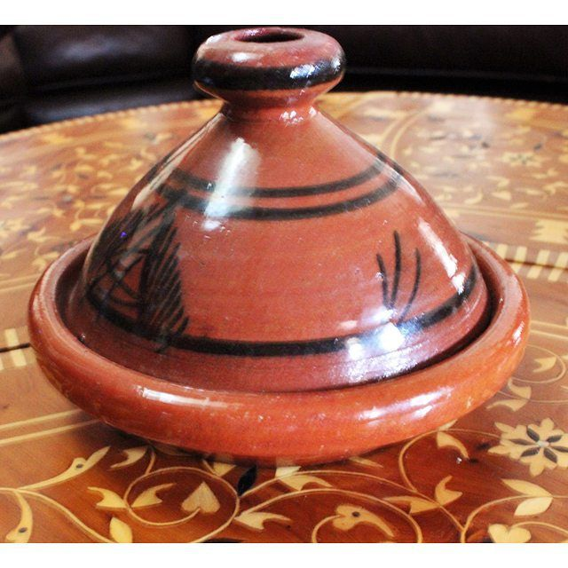 The Moroccan Tagine. A name that both describes the actual pottery dish and the food that is served in it.  Used to cook meat/veggies combinations on low heat.  #moroccanfood