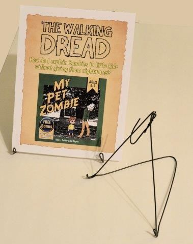 How to make a recycled wire hanger display