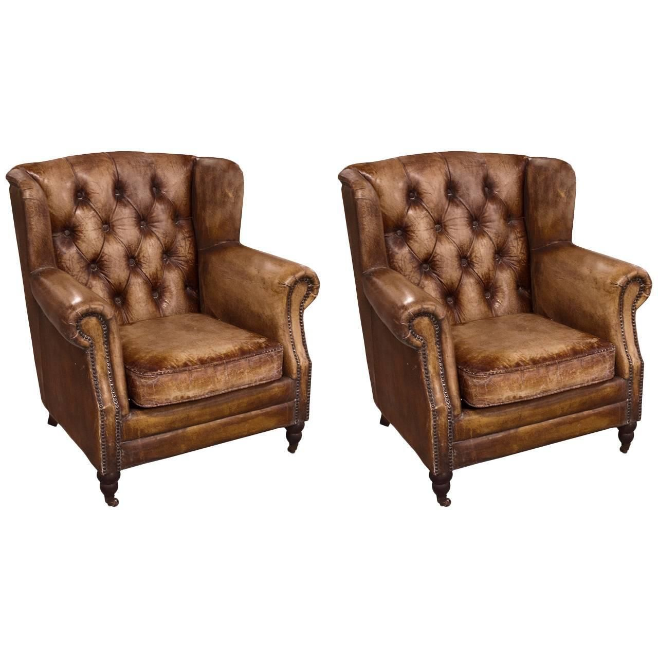 pair of english library chairs with distressed leather | modern