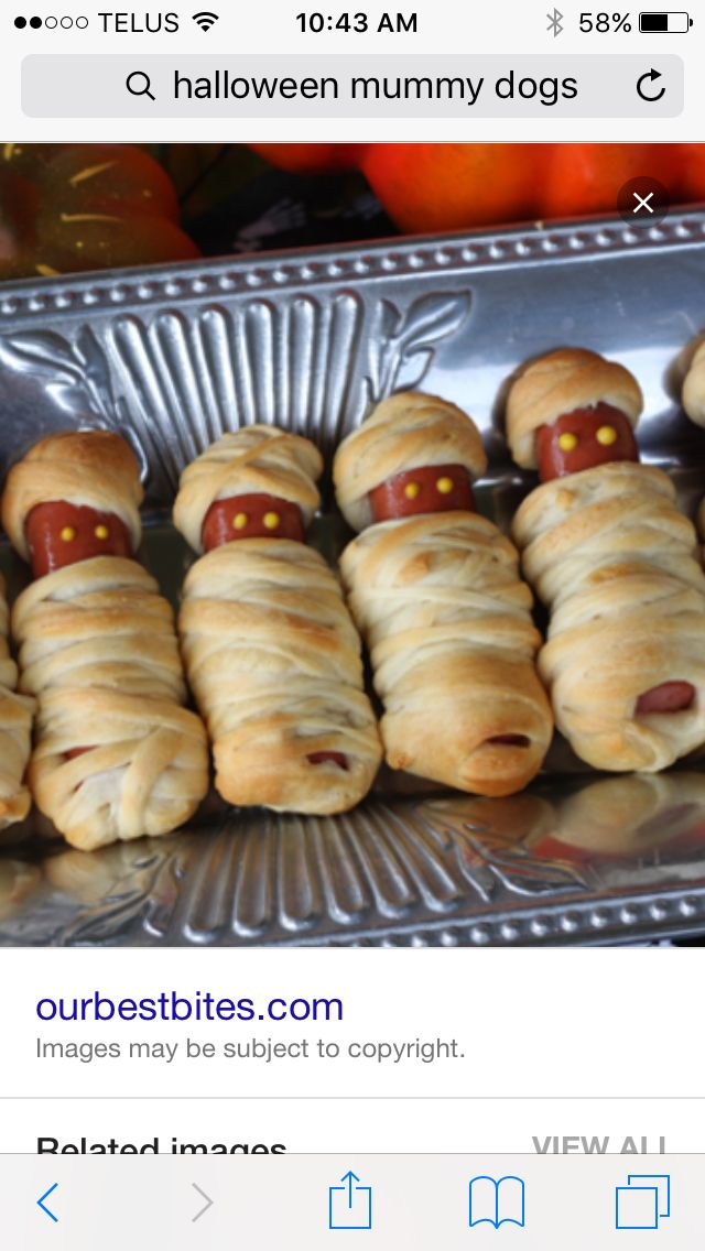 Super cute and easy hot dog mummies for Halloween.  All you need is hot dogs  and Weiner wrap slice vertically into long strips and wrap your hot dogs then bake as instructed  and your done