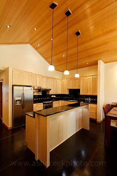 Maple Cabinets With Black Granite Countertops. Very Dramatic; Hard To Keep  Clean, But A Nice Look.