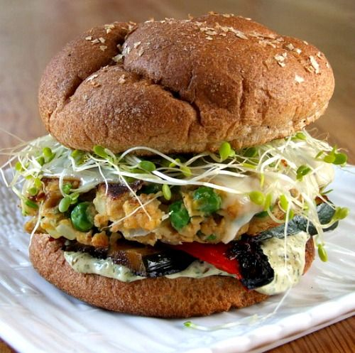 Veggie Burgers dressed with sprouts, roasted red peppers & cilantro mayonnaise