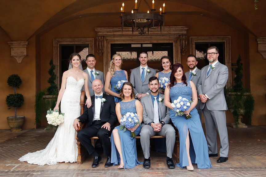 Bridesmaids Wearing Long Steel Blue Dresses Groomsmen Grey Suits With Hints Of And The Bride A Lillian Lottie Ivory Lace