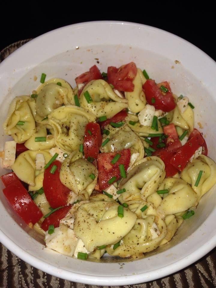 Mmm- fresh pressed garlic, Italian sausage tortellini, fresh mozzarella , oregano, chives , tomato - tossed in olive oil- yum!!