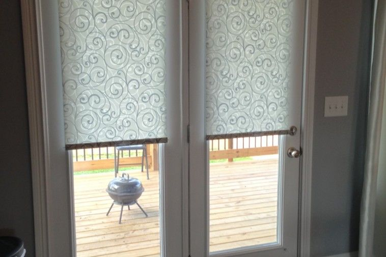 Roll Up Roman Shades On White Frame Patio Door Combined With Grey