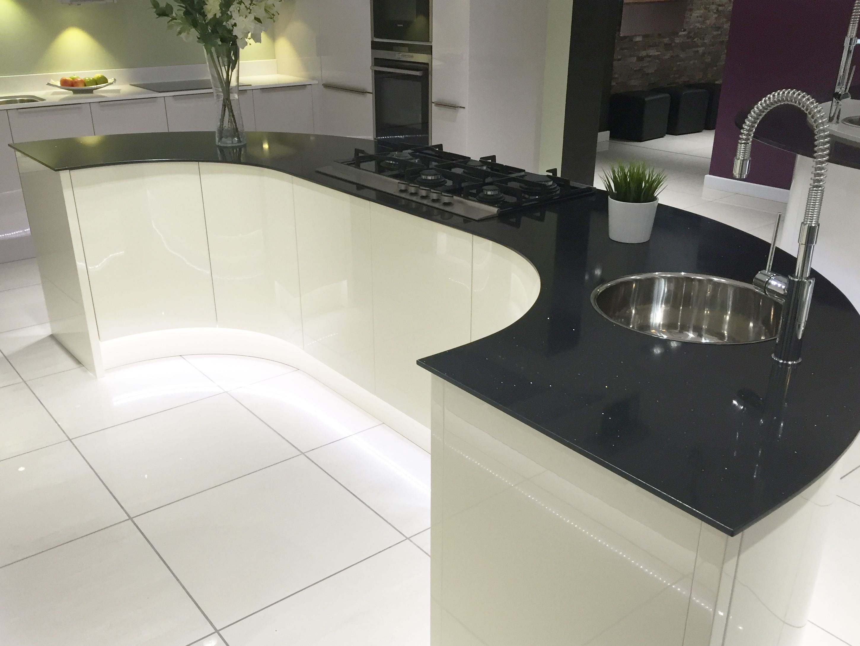 Modern kitchen island design in gloss ivory with large for Curved kitchen units uk