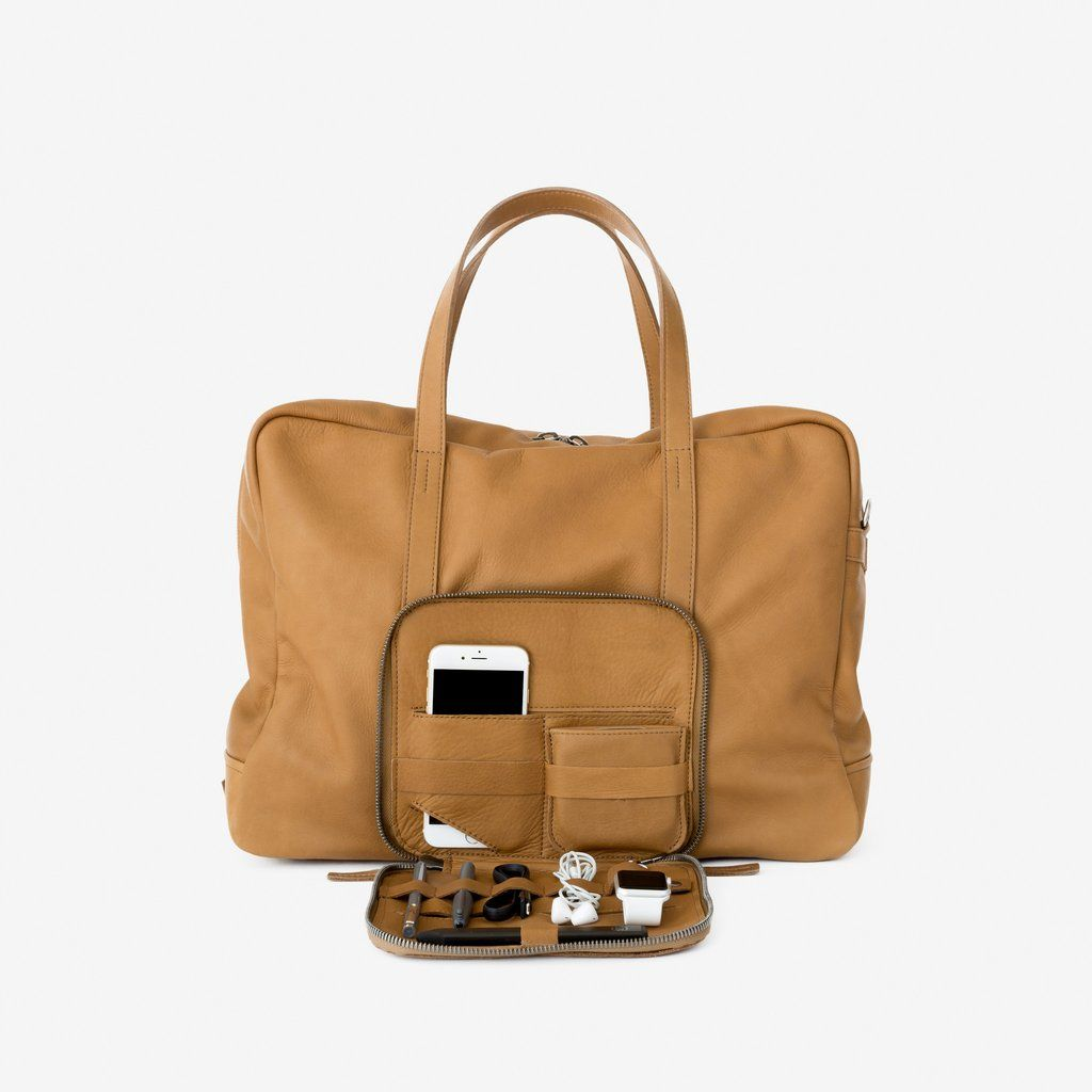 64b481694600 Voyager Weekender leather carryall by This is Ground. Perfect chic bag for  all your tech gear.