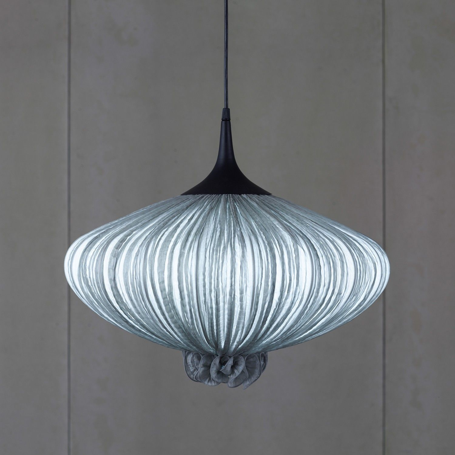 The Suuria Pendant Light was designed in 1997 and is a member of the Morning Glory collection.