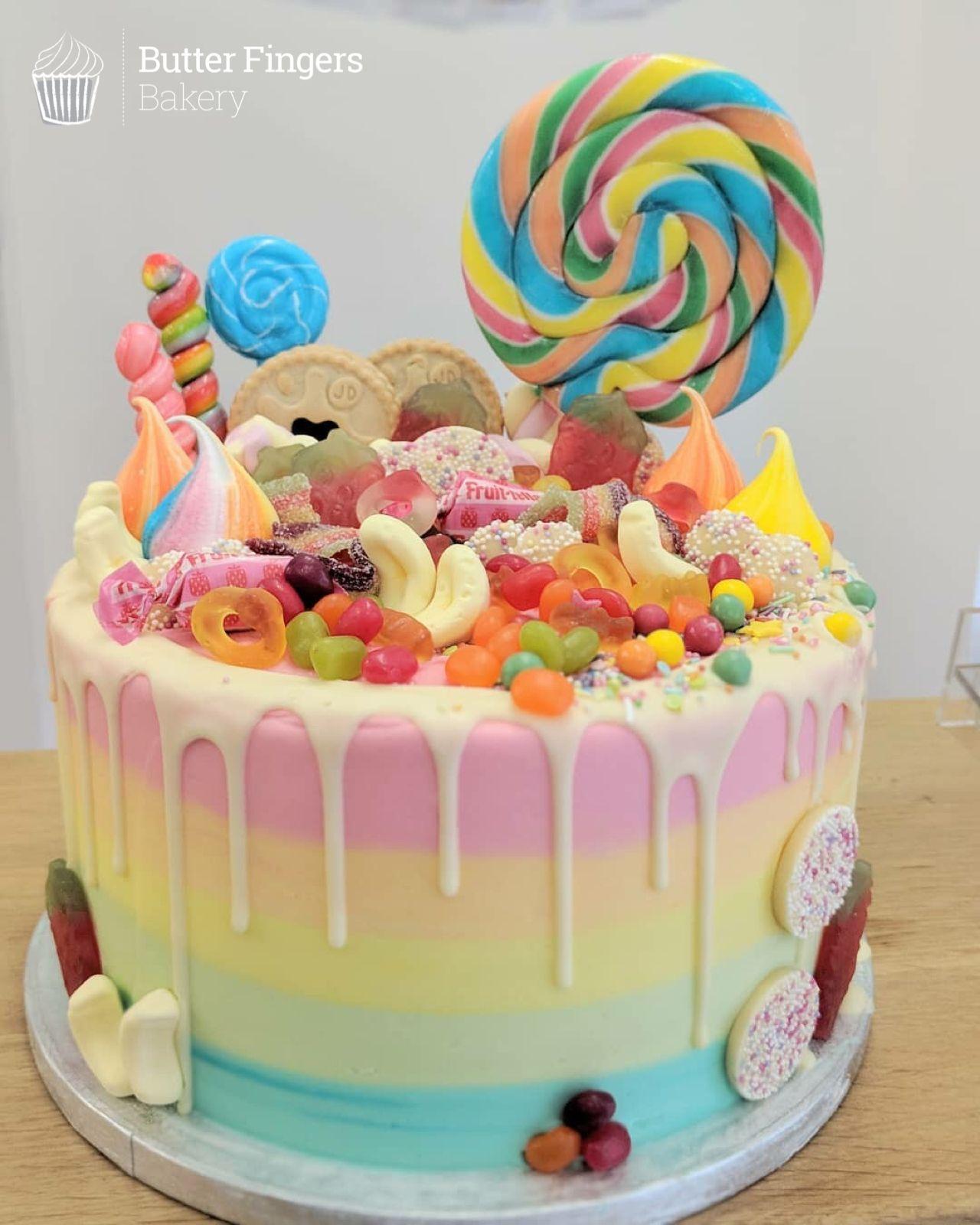 A rainbow buttercream sweetie overload cake cake