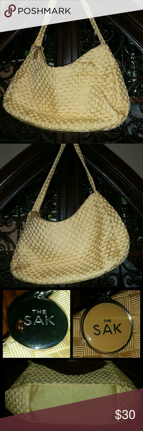 """The Sak Large Woven Banana Yellow Shoulder Bag Like new condition large, beautiful, banana yellow, The Sak Woven Shoulder Bag.  This bag is new without tags without any stains, marks,  or noticeable wear.   Woven pattern exterior with cotton interior lining.   Back wall zip pocket and double slip pockets  The Sak logo hang-tag In Chrome and coordinating yellow enamel. Measures 15"""" L x 5"""" W x 8"""" H with a 12 """" drop shoulder strap. The Sak Bags Shoulder Bags"""