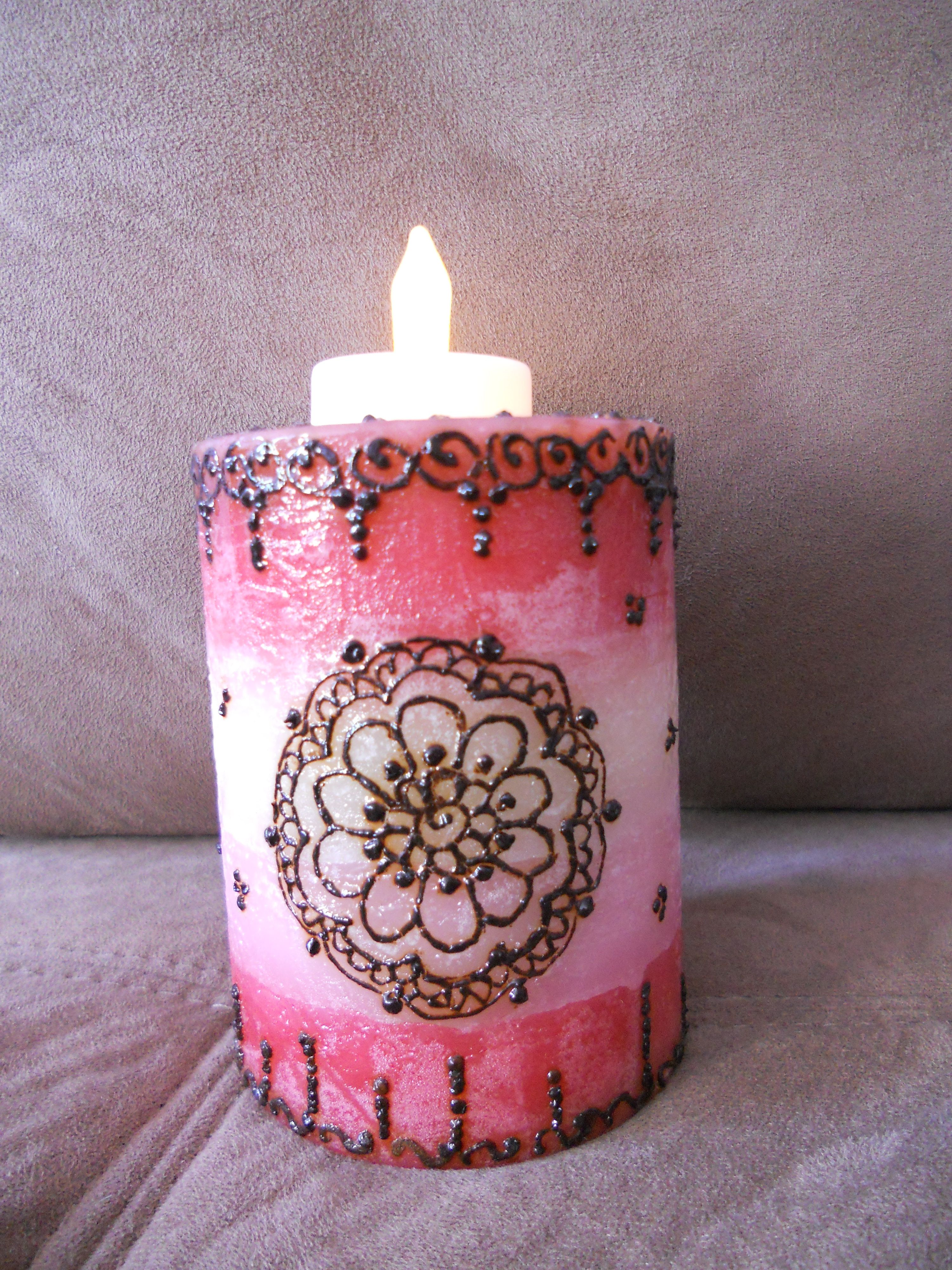 Henna design on the candle. Instead and burning the candle and ...